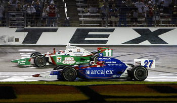 FORT WORTH, TX - JUNE 12: Tony Kanaan driver of the #11 Team 7-Eleven Andretti Green Racing Honda Dallara celebrates with his teamate Dario Franchitti driver of the #27 ArcaEx Andretti Green Racing Honda Dallara after they finished first and second during
