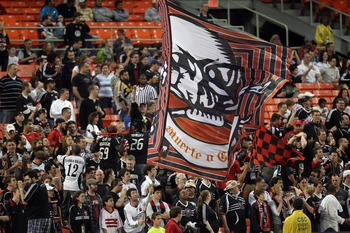 WASHINGTON, DC - MAY 14: Fans of D.C. United waive a flag against the Colorado Rapids at RFK Stadium on May 14, 2011 in Washington, DC. The game ended 1-1. (Photo by Ned Dishman/Getty Images)
