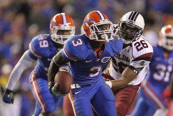 GAINESVILLE, FL - NOVEMBER 13: Chris Rainey #3 of the Florida Gators rushes after a catch against Antonio Allen #26 of the South Carolina Gamecocks during a game at Ben Hill Griffin Stadium on November 13, 2010 in Gainesville, Florida.  (Photo by Mike Ehr
