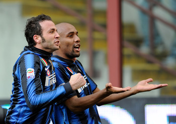 MILAN, ITALY - MARCH 06:  Giampaolo Pazzini of Inter Milan (L) celebrates scoring the opening goal with team--mate Maicon during the Serie A match between FC Internazionale Milano and Genoa CFC at Stadio Giuseppe Meazza on March 06, 2011 in Milan, Italy.