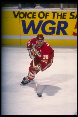 8 Dec 1991:  Center Doug Gilmour of the Calgary Flames moves the puck during a game againsst the Buffalo Sabres at Memorial Auditorium in Buffalo, New York. Mandatory Credit: Rick Stewart  /Allsport