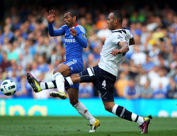 LONDON, ENGLAND - APRIL 30:  Ashley Cole of Chelsea and Younes Kaboul of Spurs compete for the ball during the Barclays Premier League match between Chelsea and Tottenham Hotspur at Stamford Bridge on April 30, 2011 in London, England.  (Photo by Clive Ro