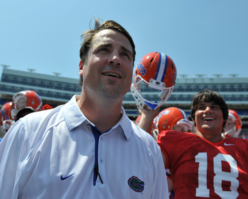 GAINESVILLE, FL - APRIL 9:  Coach Will Muschamp of the Florida Gators watches fans after the Orange and Blue spring football game April 9, 2011 at Ben Hill Griffin Stadium in Gainesville, Florida.  (Photo by Al Messerschmidt/Getty Images)
