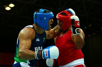 RIO DE JANEIRO, BRAZIL - JULY 23:  Antonio Rogerio Nogueira of Brazil and  Johnny Molina of Venezula exchange blows during Nogueira's win in the Super Heavy +91 kg Boxing Semifinals during the XV Pan American Games on July 23, 2007 at  in Rio De Janeiro,