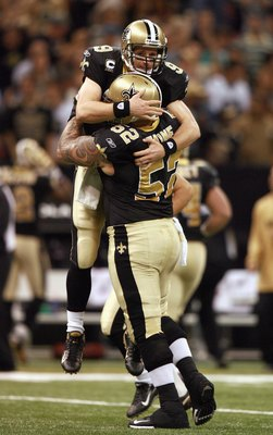 NEW ORLEANS - OCTOBER 21: Quarterback Drew Brees #9 of the New Orleans Saints celebrates with center Jeff Faine #52 after Brees threw a touchdown pass in the first quarter while taking on the Atlanta Falcons at the Superdome on October 21, 2007 in New Orl