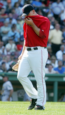BOSTON, MA - MAY 11: Keith Foulke #29 of the Boston Red Sox walks off the field after blowing a three run lead against the Oakland Athletics during a game at Fenway Park on May 11, 2005 in Boston, Massachusetts.The Red Sox defeated the Athletics 6-5.   (P