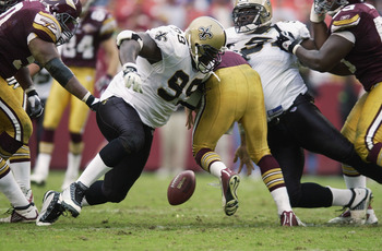 LANDOVER, MD - OCTOBER 13:  Norman Hand #99 of the New Orleans Saints tries to fall on a fumble by Patrick Ramsey #11 (C) of the Washington Redskins at FedEx Field on October 13, 2002 in Landover, Maryland. (Photo by Ezra Shaw/Getty Images)