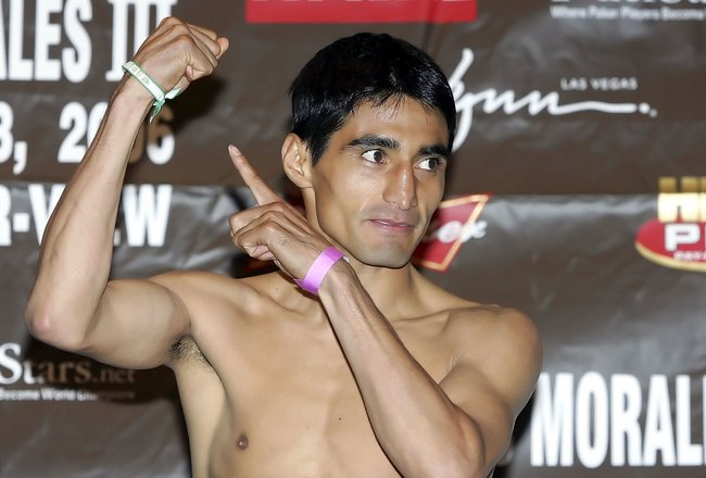 LAS VEGAS - NOVEMBER 17:  Erik Morales of Mexico points to his hand and during the official weigh-in for his bout against Manny Pacquiao of the Philippines at the Thomas & Mack Center on November 17, 2006 in Las Vegas, Nevada. The boxers will meet for the