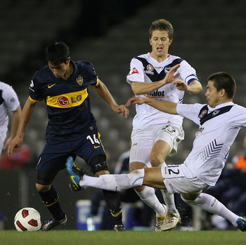 MELBOURNE, AUSTRALIA - JULY 16:  Rodrigo Vargas of the Melbourne Victory tries to tackle Sergio Araujo of the Boca Juniors during the pre-season International Friendly between Melbourne Victory and Argentina's Boca Juniors at Etihad Stadium on July 16, 20