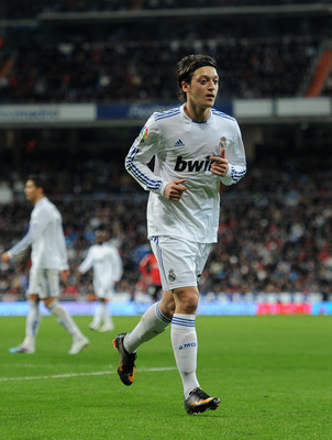 MADRID, SPAIN - JANUARY 23:  Mesut Ozil of Real Madrid runs on the pitch during the la liga match between Real Madrid and Mallorca at Estadio Santiago Bernabeu on January  23, 2011 in Madrid, Spain.  (Photo by Jasper Juinen/Getty Images)
