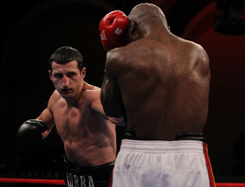 ATLANTIC CITY, NJ - JUNE 04:  Carl Froch punches Glen Johnson during their WBC Super Middleweight title bout at Boardwalk Hall on June 4, 2011 in Atlantic City, New Jersey.  (Photo by Al Bello/Getty Images)