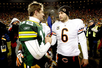 GREEN BAY, WI - JANUARY 02:  Quarterback Aaron Rodgers #12 of the Green Bay Packers is congratukated by quarterback Jay Cutler #6 of the Chicago Bears at Lambeau Field on January 2, 2011 in Green Bay, Wisconsin.  (Photo by Matthew Stockman/Getty Images)