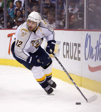 VANCOUVER, CANADA - APRIL 28: Mike Fisher #12 of the Nashville Predators skates with the puck during Game One of the Western Conference Semifinals against the Vancouver Canucks during the 2011 NHL Stanley Cup Playoffs on April 28, 2011 at Rogers Arena in