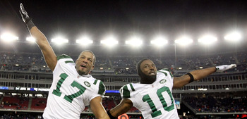 FOXBORO, MA - JANUARY 16:  Braylon Edwards #17 and Santonio Holmes #10 of the New York Jets celebrate on their way to defeating the New England Patriots 28 to 21 victory over the New England Patriots during their 2011 AFC divisional playoff game at Gillet