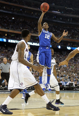 HOUSTON, TX - APRIL 02:  Brandon Knight #12 of the Kentucky Wildcats shoots against the Connecticut Huskies during the National Semifinal game of the 2011 NCAA Division I Men's Basketball Championship at Reliant Stadium on April 2, 2011 in Houston, Texas.