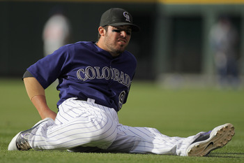DENVER, CO - APRIL 16:  Ian Stewart #9 of the Colorado Rockies stretches prior to facing the Chicago Cubs at Coors Field on April 16, 2011 in Denver, Colorado.  (Photo by Doug Pensinger/Getty Images)