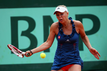 PARIS, FRANCE - MAY 27:  Caroline Wozniacki of Denmark hits a forehand during the women's singles round three match between Caroline Wozniacki of Denmark and Daniela Hantuchova of Slovakia on day six of the French Open at Roland Garros on May 27, 2011 in