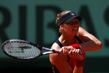 PARIS, FRANCE - MAY 29:  Vera Zvonareva of Russia hits a backhand during the women's singles round four match between Vera Zvonareva of Russia and Anastasia Pavlyuchenkova of Russia on day eight of the French Open at Roland Garros on May 29, 2011 in Paris