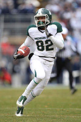 STATE COLLEGE, PA - NOVEMBER 27: Wide receiver Keshawn Martin #82 of the Michigan State Spartans runs with the ball during a game against the Penn State Nittany Lions on November 27, 2010 at Beaver Stadium in State College, Pennsylvania. The Spartans won