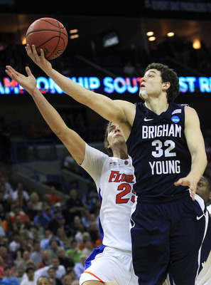 NEW ORLEANS, LA - MARCH 24:  Jimmer Fredette #32 of the Brigham Young Cougars shoots over Chandler Parsons #25 of the Florida Gators in the second half during the Southeast regional of the 2011 NCAA men's basketball tournament at New Orleans Arena on Marc