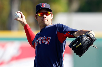 BRADENTON, FL - MARCH 13:  Outfielder Josh Reddick #68 of the Boston Red Sox warms up just prior to the start of the Grapefruit League Spring Training Game against the Pittsburgh Pirates at McKechnie Field on March 13, 2011 in Bradenton, Florida.  (Photo
