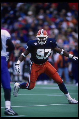 28 Oct 1995:  Linebacker Simeon Rice #97 of the Illinois Fighting Illini goes up against some Wildcats from Northwestern at Memorial Stadium in Champaign, Illinois.  Northwestern defeated Illinois 17-14.  Mandatory Credit:  Jonathan Daniel/Allsport