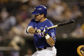 ARLINGTON, TX - JULY 11:  First baseman Rafael Palmeiro #25 of the Texas Rangers swings at a Kansas City Royals pitch during the MLB game at the Ballpark in Arlington on July 11, 2003 in Arlington, Texas. The Royals won 13-3.  (Photo by Ronald Martinez/Ge
