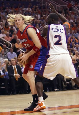 PHOENIX - MAY 8:     Chris Kaman #35 of the Los Angeles Clippers drives against Tim Thomas #2 of the Phoenix Suns in game one of the Western Conference Semifinals during the 2006 NBA Playoffs on May 8, 2006 at US Airways Arena in Phoenix, Arizona.  NOTE T