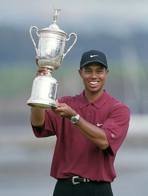 18 Jun 2000:  Tiger Woods poses with his trophy after winning the 100th US Open at the Pebble Beach Golf Links in Pebble Beach, California.Mandatory Credit: Jamie Squire  /Allsport