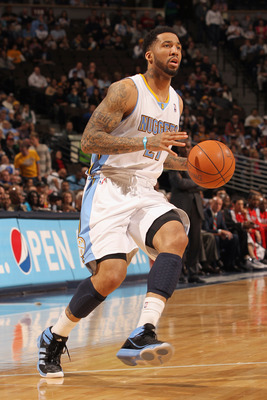 DENVER, CO - FEBRUARY 28:  Wilson Chandler #21 of the Denver Nuggets controls the ball against the Atlanta Hawks during NBA action at the Pepsi Center on February 28, 2011 in Denver, Colorado. The Nuggets deafeated the Hawks 100-90. NOTE TO USER: User exp