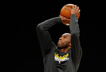 LOS ANGELES, CA - MAY 04:  Kobe Bryant #24 of the Los Angeles Lakers shoots nearly three-hours before tip-off against the Dallas Mavericks before Game Two of the Western Conference Semifinals in the 2011 NBA Playoffs at Staples Center on May 4, 2011 in Lo