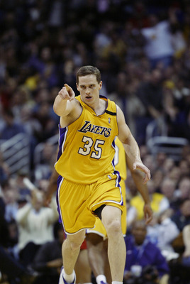 LOS ANGELES - FEBRUARY 25:  Mark Madsen #35 of the Los Angeles Lakers celbrates during the NBA game against the Los Angeles Clippers at Staples Center on February 25, 2003 in Los Angeles, California.  The Lakers won 109-98.  NOTE TO USER: User expressly a