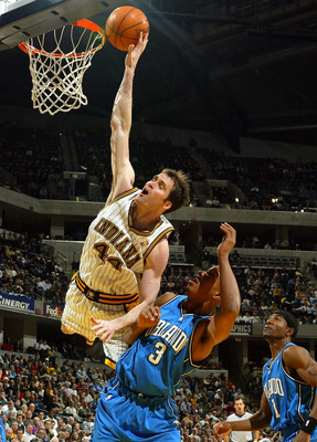 INDIANAPOLIS - DECEMBER 17:  Austin Croshere #44 of the Indiana Pacers tries to tip the ball in the basket while defended by Keith Bogans #3 of the Orlando Magic on December17, 2003 at Conseco Fieldhouse in Indianapolis, Indiana.  (Photo by Andy Lyons/Get