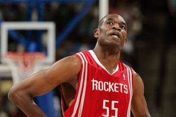 DENVER - APRIL 17:  Dikembe Mutombo #55 of Houston Rockets looks up at the clock in the fourth quarter against the Denver Nuggets on April 17, 2006 at the Pepsi Center in Denver, Colorado. The Rockets won 86-83.  NOTE TO USER: USER expressly acknowledges