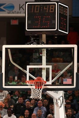 INDIANAPOLIS - MARCH 14:  A detail of the backboard and shot clock as a basketball goes thru the hoop as the Michigan State Spartans play against the Ohio State Buckeyes during their semifinal game of the Big Ten Men's Basketball Tournament at Conseco Fie