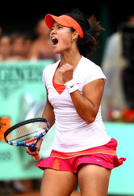 PARIS, FRANCE - JUNE 04:  Na Li of China celebrates a point during the women's singles final match between Francesca Schiavone of Italy and Na Li of China on day fourteen of the French Open at Roland Garros on June 4, 2011 in Paris, France.  (Photo by Cli