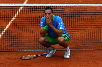 PARIS, FRANCE - MAY 31:  Viktor Troicki of Serbia disputes a call by the Umpire after a ball bay ran onto the court whilst a point was still in play during the men's singles round four match between Andy Murray of Great Britain and Viktor Troicki of Serbi