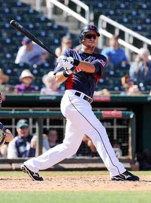 GOODYEAR, AZ - MARCH 11:  Lonnie Chisenhall #76 of the Cleveland Indians follows through on a swing against the Seattle Mariners at Goodyear Ballpark on March 11, 2011 in Goodyear, Arizona.  (Photo by Norm Hall/Getty Images)
