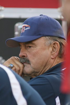 LOS ANGELES - SEPTEMBER 13:  NFL Hall of Famer Dick Butkus looks on from the endzone at halftime of the game between the Ohio State Buckeyes and the USC Trojans on September 13, 2008 at the Los Angeles Memorial Coliseum in Los Angeles, California.  USC wo