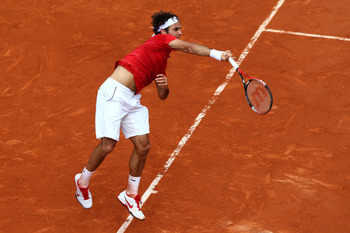 PARIS, FRANCE - JUNE 05:  Roger Federer of Switzerland serves during the men's singles final match between Rafael Nadal of Spain and Roger Federer of Switzerland on day fifteen of the French Open at Roland Garros on June 5, 2011 in Paris, France.  (Photo