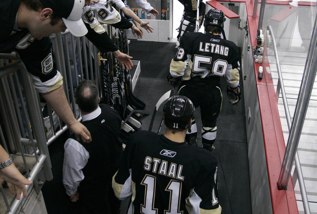 PITTSBURGH, PA - APRIL 23:  Jordan Staal #11, Kris Letang #58, and Brent Johnson #1 of the Pittsburgh Penguins take the ice for warm ups before the start of Game Five of the Eastern Conference Quarterfinals against the Tampa Bay Lightning during the 2011