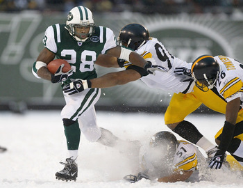 EAST RUTHERFORD, NJ - DECEMBER 14:  Curtis Martin #28 of the New York Jets tries to outrun Kendrell Bell #97, James Farrior #51, and Deshea Townsend #26 of the Pittsburgh Steelers on December 14, 2003 at Giant Stadium in East Rutherford, New Jersey. The J