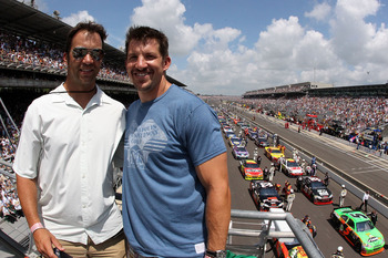 INDIANAPOLIS - JULY 25:  (R-L) Dallas Clark of the NFL's Indianapolis Colts poses with brother Dan Clark in the flag stand before the NASCAR Sprint Cup Series Brickyard 400 at Indianapolis Motor Speedway on July 25, 2010 in Indianapolis, Indiana.  (Photo