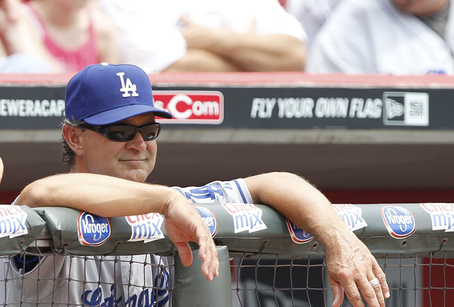 CINCINNATI, OH - JUNE 5: Los Angeles Dodgers manager Don Mattingly looks on during the game against the Cincinnati Reds at Great American Ball Park on June 5, 2011 in Cincinnati, Ohio. The Dodgers defeated the Reds 9-6. (Photo by Joe Robbins/Getty Images)