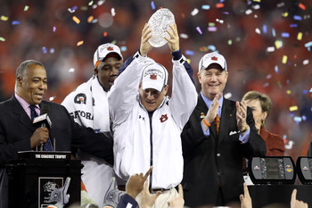 GLENDALE, AZ - JANUARY 10:  Head coach Gene Chizik of the Auburn Tigers celebrates the Tigers 22-19 victory against the Oregon Ducks during the Tostitos BCS National Championship Game at University of Phoenix Stadium on January 10, 2011 in Glendale, Arizo
