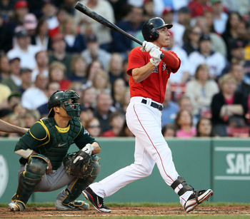 BOSTON, MA - JUNE 03: Jacoby Ellsbury #2 of the Boston Red Sox gets a hit in the first inning as Kurt Suzuki #8 of the Oakland Athletics defends on June 3, 2011 at Fenway Park in Boston, Massachusetts.  (Photo by Elsa/Getty Images)