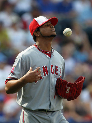 KANSAS CITY, MO - MAY 30:  Starting pitcher Ervin Santana #54 of the Los Angeles Angels of Anaheim reacts after letting in a run during the game against the Kansas City Royals on May 30, 2011 at Kauffman Stadium in Kansas City, Missouri.  (Photo by Jamie