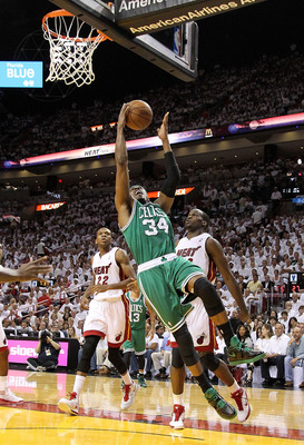 MIAMI, FL - MAY 11:  Paul Pierce #34 of the Boston Celtics drives against Joel Anthony #50 of the Miami Heat during Game Five of the Eastern Conference Semifinals of the 2011 NBA Playoffs at American Airlines Arena on May 11, 2011 in Miami, Florida. NOTE