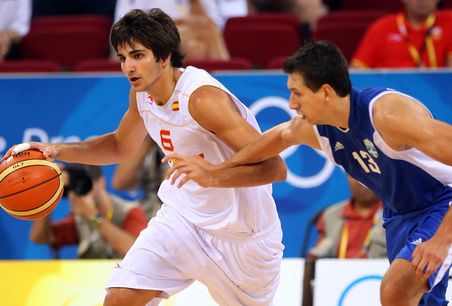 BEIJING - AUGUST 10:  Ricky Rubio #6 of Spain drives on Dimitrios Diamantidis #13 of Greece during the day 2 preliminary game at the Beijing 2008 Olympic Games in the Beijing Olympic Basketball Gymnasium on August 10, 2008 in Beijing, China.  (Photo by Ph