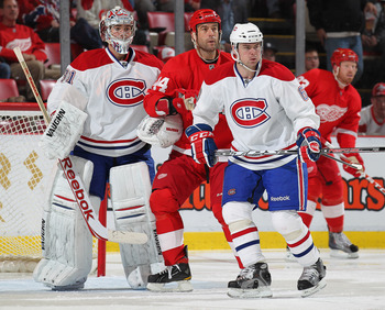 DETROIT,MI - DECEMBER 10:  Goaltender Carey Price #31 and Jaroslav Spacek #6 of the Montreal Canadiens sandwich Todd Bertuzzi #44 of the Detroit Red Wings during the game at the Joe Louis Arena on December 10, 2010  in Detroit, Michigan. The Wings defeate